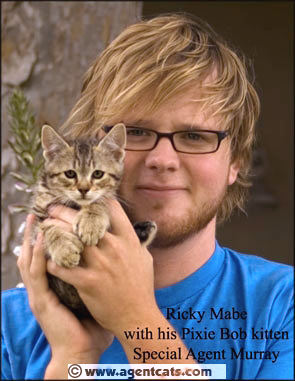 Actor Ricky Mabe and Murray, a Pixie Bob kitten